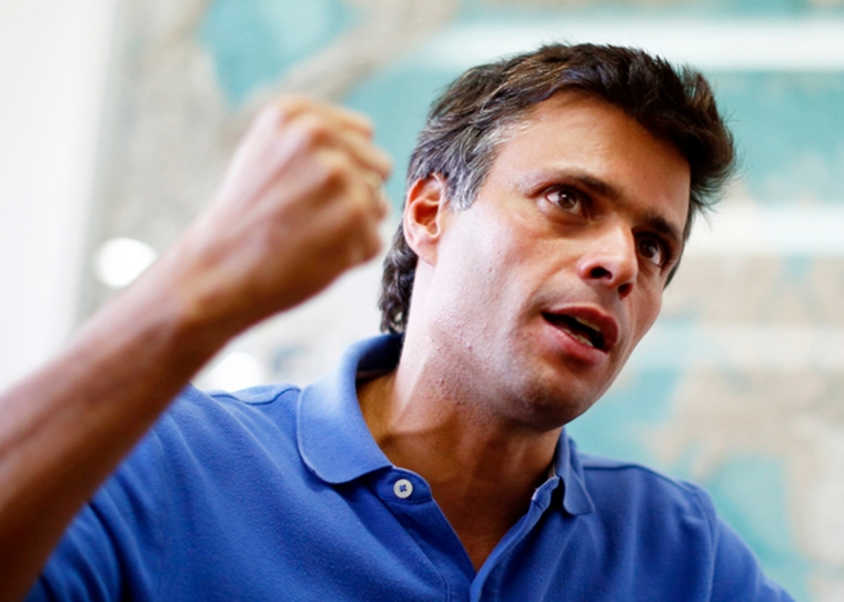 Venezuelan opposition leader Lopez gestures while speaking during an interview with Reuters in Caracas